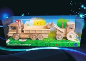 Ciężarówka i ciągnik z lemieszem z drewna