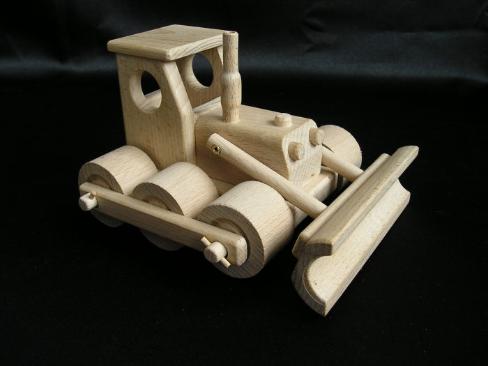 Spychacz i ciężarówki z drewna